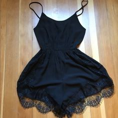 Romper with lace detail NWOT Super cute black romper with lace detail. So sad that is it to short and tight on me! :( never been worn. Super cute for summer festivals or date night with a pair of heels! Dresses Mini