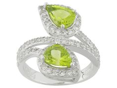 1.87ctw Pear Shape Peridot Wtih 1.06ctw Round White Topaz Sterling Sil