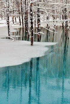 Blue Pond & Spring Snow. Hokkaido, Japan