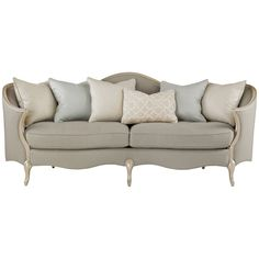 Charmingly curved, this elegant Caracole sofa will add a soft touch of romance to any room. Its beautiful French-inspired silhouette is crafted from pearlescent powder puff finished birch wood framing