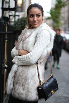Faux Fur vest coats are glamorous and stylish. This mottled furs is gorgeous and warming.