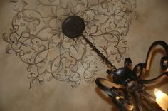Ceiling medallion with hand painted touches- modello by Modello designs. Painting by Carmen Illustrates.