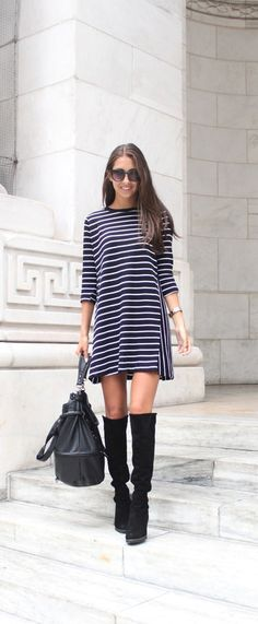 Felicia Akerstrom is wearing a striped dress from Zara, boots from Stuart Weitzman, Bag from H&M and sunglasses from Gina Tricot