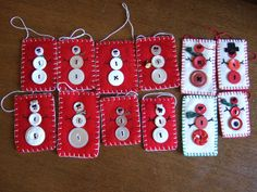 Felted sweater and blanket ornaments--red and white button snowmen, via Flickr.
