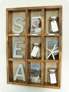 another great decor idea! this is where i'll put my beach photos, some dried sea finds and my bottled beach memories! :> ~Anny