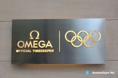 3d-lightbox-signs-with-brushed-stainless-steel-backing-box-and-whole-lit-acrylic-letters-for-omega