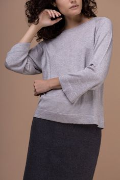 Luxuriously soft, made of silk and cashmere, light gray sweater. The Yvonne top is light & warm, a wardrobe staple with a real premium feel.