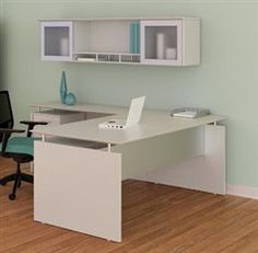 White office furniture is cutting edge and coastal! Check out this sea salt finished Medina L desk with glass accented overhead hutch.