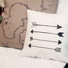 Learn how to make this super simple DIY arrow pillow, that looks good enough to have been bought but costs under $10!