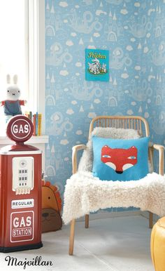 Ack! So much to love (perplexed, though, at the gas tank) in this room. The colors are happy. The patterns and textures create interest. The fox!