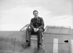 """F/O Hugh N Tamblyn of No 242 Squadron RAF sits atop Hurricane Mk I LE-D at RAF Duxford in late September 1940. The Canadian pilot joined the former squadron on 8 August, claiming 5½ enemy aircraft destroyed and 1 damaged by late September. The aircraft was issued to the unit on 11 September and was the third aircraft assigned to S/L Douglas RS """"Dogsbody"""" Bader since his arrival at the squadron in late June."""