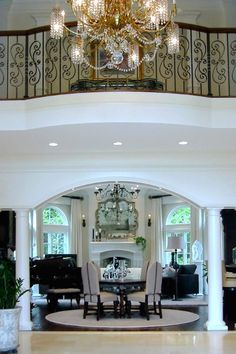 Traditional fireplace and balcony.