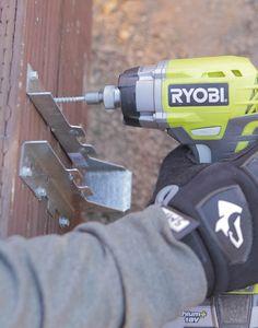 Attaching joist brackets to a backyard deck