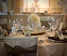 Blush satin linen and ivory chair covers create this timeless elegant look