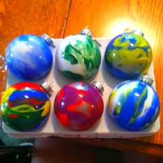 My version of homemade Christmas ornaments! Buy clear bulbs, add drops of acrylic paint and shake.  Made 18, Planning on making gift tags giving each household one ornament for christmas :)