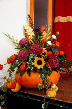 Halloween Theme - This autumn theme bouquet in a pumpkin is a lovely table centerpiece. Sunflower Floral Arrangements, Sunflower Centerpieces, Pumpkin Arrangements, Fall Table Centerpieces, Table Decorations, Autumn Decorations, Tall Centerpiece, Centerpiece Wedding, Fall Wedding Flowers