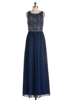 Riverfront Regalia Dress. The scene is set for a magical evening - strings of lights hang from the trees, the setting sun reflects beautifully on the water, and you flaunt this striking navy-blue gown. #blue #modcloth