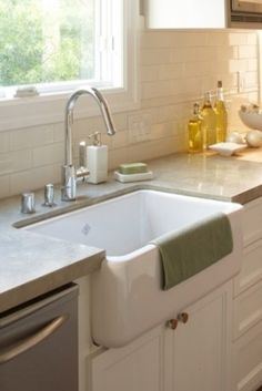 Farm house sink, subway tile and light granite counter tops. love this but maybe with cement counters