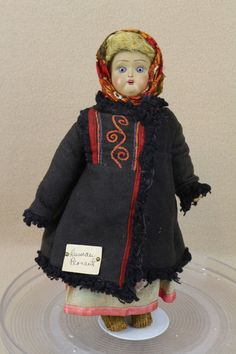 "Paper label on her coat says ""RUSSIAN PEASANT"". There is a small piece of paper that says ""from North Russia"". She is original from head to toe. Doll has a light brown Terra Cotta swivel socket head with jointed composition wood body. 