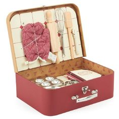 A beautifully crafted patisserie baking set housed in a retro cardboard suitcase. It features everything budding Patisserie Chefs need to help out in the kitchen.As well as the cardboard case, the set includes a mini rolling pin, pastry tin, heart and star cutters, a recipe book, oven mit and a patterned red and white apron. This classically designed set will inspire a love of baking to last a lifetime and young children will enjoy helping to bake delicious treats! Suitable for ages 6 years…