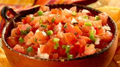 PICO DE GALLO - This fresh uncooked Mexican salad/dip combines chopped tomatoes, chopped onions, chopped chilli, chopped coriander and lime juice. Bursting with fresh flavours and ingredients; this very simple dish is perfect to enjoy with tortilla style chips.