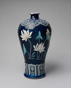 Bottle with Lotuses, Ming dynasty late century. Porcelain with raised slip and enamels (Jingdezhen ware). Bequest of John D., © The Metropolitan Museum of Art. Chinese Culture, Chinese Art, Glass Ceramic, Ceramic Art, Meneses, Japanese Porcelain, White Porcelain, Chinese Ceramics, 15th Century