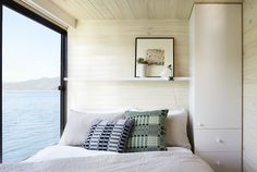 Bedroom with a view in a dream houseboat on lake Eildon. . Design: Pipkorn & Kilpatrick. Photos: Christina Francis.