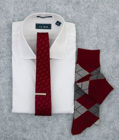 Pair our Pinpoint Solid shirt with a rich burgundy tie, perfect for the holidays. www.TheTieBar.com