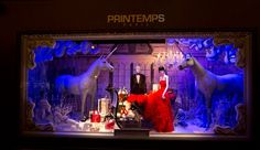 Photos: Photos: Around the World in 2012 Holiday Windows   Vanity Fair PRINTEMPS An elegant couple poses in a winter garden flanked by two gallant unicorns that are no doubt there to keep watch on the sleigh full of Dior shoes, bags, and perfumes.
