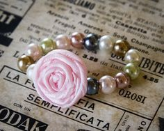 Newborn Baby Rosette Bracelet, Glass Bead Pearl Bracelet with fabric flower for up to 5 months, photo prop, baby shower gift, pale pink. $4.95, via Etsy.