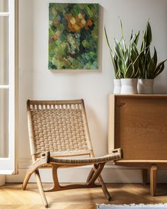 May 2013 Issue - A folding chair beside a wooden credenza