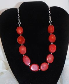 I've seen this necklace design in stores - mine was first, of course! It is a single row of large, red bamboo coral sections alternating with silver beads. These are then hanging on a silverplate chain, ending with a silverplate hook and eye fastener. It is 20 inches long and has an attached 2 inch extender.