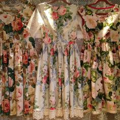"""3 floral dresses, 2 off to their homes of special occasions and the one on the left is for sale, size 10. Very difficult to capture colours and prints in…"""