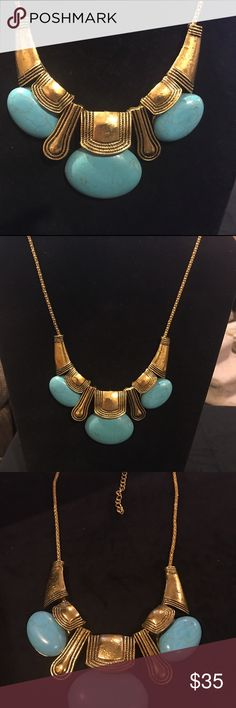 """NWOT Turquoise & Gold Statement Necklace. NWOT Turquoise & Gold Statement Necklace. Never worn. Turquoise colored stones have that crackled look. Gold tone accents & chain. Lobster closure with 2"""" extension. Beautiful statement piece. Jewelry Necklaces"""