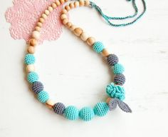 black Friday Sale !  This teething necklace is a perfect toy for playing and while feeding your baby. It is a real godsend for moms, just the best accessory for slinging moms! Made with natural, unfinished wooden beads (beech or juniper) and crocheted with 100% cotton yarn.  It's a good baby shower gift, perfect for baby wearing mamas, improves you baby's motor skills, safe for your baby to chew. Washable (hand wash with mild soap).  The biggest crochet beads are about 1 in diameter (24 mm)…
