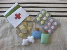 This item is a first aid kit.    band-aid tablets  medicine bottles  cotton balls    Each piece is made of felt.  It is completely handmade.  It can be