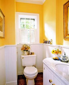Bright and Cheery Bath  Following water damage, the owners of this powder room decided to replace plaid wallpaper and an old brown toilet with new fixtures and a two-part wall treatment. Now, beaded board and bright yellow paint give the room vintage character. A narrow chair railing caps the wainscoting and forms a small ledge for display.