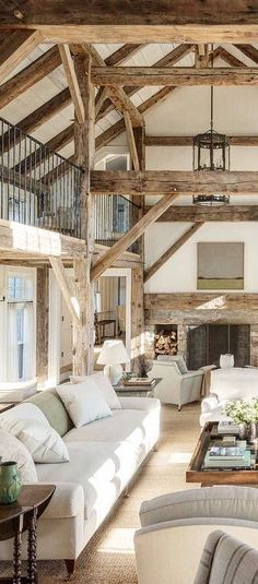 Living Room decor - rustic farmhouse style with open beam and light neutral color palette. | Mark Cunningham Inc.
