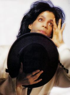 Classic Prince | 1990 Graffiti Bridge | One of my most favorite photo sessions from late 1990, Prince in a white suit and hat dancing and making funny faces!