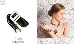 Rudy  www.rudysrl.com    orologio in acciaio trattato in pvd, Ag925 e pietre idrotermali; collana in acciaio trattato in pvd, Ag925 e zirconi  bracciale in acciaio trattato in pvd, Ag925 e zirconi