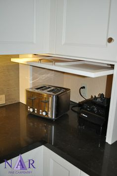 Different Example: Lift Up Door Style to Hide Kitchen Appliances. Easy Access to appliance without blocking access to the cabinets above. I love the idea of the outlet being hidden inside the appliance garage too!. Would need Very Deep Countertops. Need room to pull out and use the appliances without having heat damage the cabinets above.