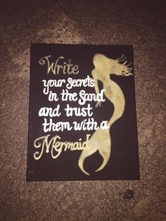Mermaid Home Decor; All supplies found at Michaels Craft Store: Black canvas, white acrylic paint, sand, Elmer's Glue. I found a picture of a mermaid silhouette online, printed it, cut it out and used it as a stencil. I outlined the whole body with Elmer's Glue, as well as some words, then sprinkled sand on top.