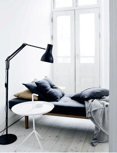 Love the daybed... This renovated townhouse has been skilfully furnished with a mix of old and new adding character and personality to a minimal and contemporary style.