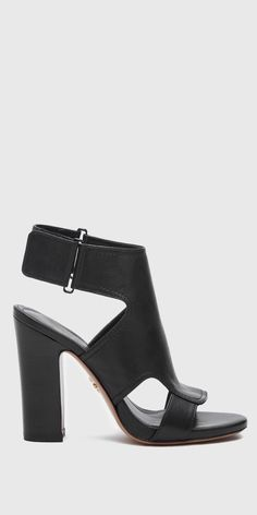 Echo - Chunky/stacked high heel sandal. Cut-out details at vamp. Hook and loop (Velcro) closure at ankle strap. Nappa upper. 105mm heel.
