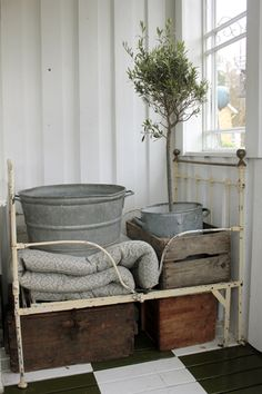 Zinc, crates/boxes, old bed and olive tree all country charm.  Me likes, me wants!