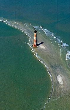Beach erosion has moved the Morris Island Lighthouse 400 yards offshore. South Carolina.
