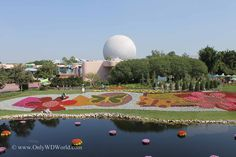 Beautiful Epcot Gardens with view of Spaceship Earth