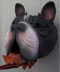 Handcrafted Boston Terrier is Birdhouse is handmade with passion and a sense of humor... and no two are alike! Fantastic dog art provides a perfect nest site in spring, and swell roosting spot through