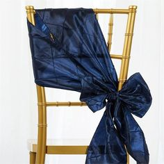 Navy Blue Pintuck Chair Sash | eFavorMart / Pintuck is actually a fold of fabric that is stitched intricately to hold it in a place, very much like a pleat. These lovely pleats impart a decorative effect to the fabric by fashioning a visual line at a chosen point. They effortlessly bridge vintage and contemporary styles to create a majestic new classic look. If you do not want your celebration to blend in with other weddings, birthdays, and anniversaries, try our premium quality pintuck…