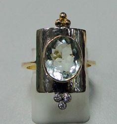 Vintage 18 k gold diamond aquamarine ring art deco. $550.00 USD, via Etsy.